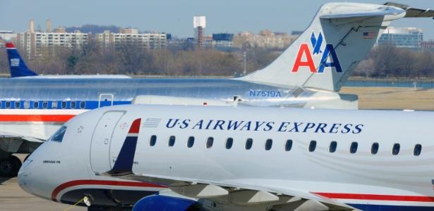 aeronaves-da-american-airlines-e-da-us-airways-no-aeroporto-nacional-ronald-reagan-na-virginia-a-fusao-das-duas-deve-criar-a-maior-empresa-aerea-do-mundo-1360767676474_615x300
